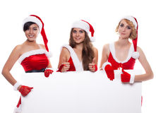 Christmas people three happy women in santa helper hat with blan Royalty Free Stock Image