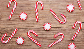 Christmas. Peppermint Candy and Canes. On old wooden background Royalty Free Stock Photography