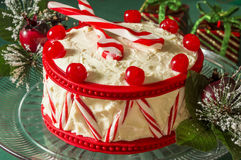 Christmas peppermint drum cake. With peppermint spoons for drumsticks a tasty holiday treat royalty free stock photography