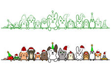 Christmas pet animals in a row with copy space. Cute Christmas pets in a row with copy space Royalty Free Stock Photo