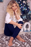 Christmas photo of beautiful woman with blond hair in elegant cl. Fashion interior holiday Christmas photo of beautiful woman with blond hair in elegant clothes Royalty Free Stock Photos
