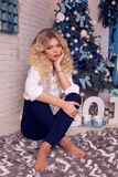 Christmas photo of beautiful woman with blond hair in elegant cl. Fashion interior holiday Christmas photo of beautiful woman with blond hair in elegant clothes Royalty Free Stock Photography