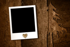 Christmas, photo frame hanging on an old wooden wall Royalty Free Stock Image