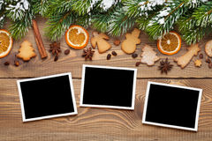 Christmas photo frames, tree, spices and cookies Stock Photos