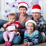 Christmas photo of a happy family Stock Photos
