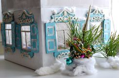 Christmas photo with house, fir and snow. Retro small Russian house, New Year tree and snow - Christmas postcard Stock Images
