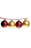 Christmas photo of red and gold ornaments strung on plaid ribbon royalty free stock images