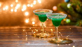 Christmas photo of two wine glasses with green cocktail Stock Image
