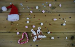 Christmas photography food and drink image with hot chocolate cup and mini marshmallows shaped as happy snowman Stock Photos