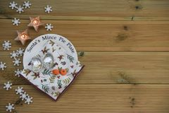 Christmas photography image of Santa mince pie plate showing eaten carrot from reindeer and empty plate with star shape candle Stock Photos