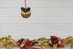Christmas photography image of xmas decoration hanging up of food pudding with festive gold xmas background on white wood. Xmas decoration with white wood Royalty Free Stock Photos