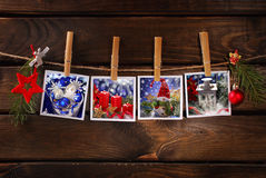 Christmas photos hanging on rope against wooden background Royalty Free Stock Images