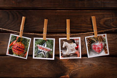 Christmas photos hanging on rope against wooden background Royalty Free Stock Photos