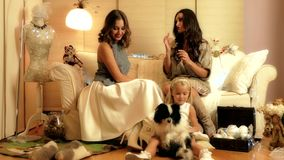 Christmas photosession with two girls, a child and a dog in warm light studio. 4k video stock video