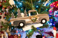 Christmas pickup car decoration on a tree. Christmas tree decoration in the form of the pickup truck hauling trees royalty free stock image