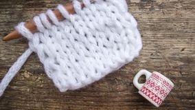 Christmas picture with a knitted cloth and a mug with a pattern stock image