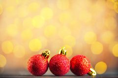 Christmas picture of red Christmas balls and yellow bokeh. Happy New Year greetings concept. Christmas picture of the background of red Christmas balls and royalty free stock image