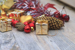 Christmas picture with red and gold toys. On wooden background stock photography
