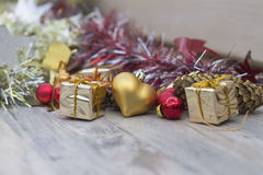 Christmas picture with red and gold toys. On wooden background stock image