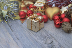 Christmas picture with red and gold toys. On wooden background royalty free stock photo