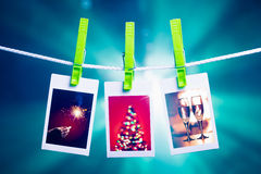 Christmas pictures on blue lights background. Christmas pictures hanging on rope, blue lights background Stock Image