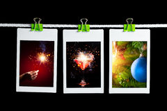 Christmas pictures hanging on rope Stock Photography