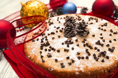 Christmas pie decorated with holly twig and balls in festive set Royalty Free Stock Images