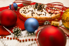 Christmas pie decorated with holly twig and balls in festive set Stock Photography