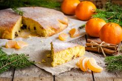 Christmas Piece Of Biscuit Cake With Mandarin Oranges And Cinnamon Royalty Free Stock Images