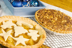 Christmas Pies and Decorations on a Wooden Table Stock Photo