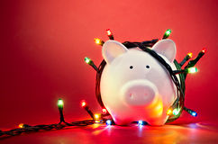 Christmas piggy bank. Piggy bank wrapped in Christmas string lights