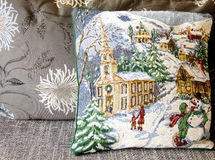 Christmas Pillow on grey colored Sofa Royalty Free Stock Photography
