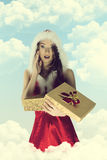 Christmas pin-up girl with gift box Stock Images