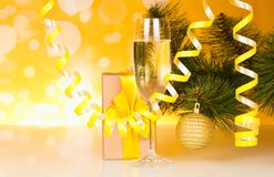 Christmas pine branche are festively decorated, glass of champag Royalty Free Stock Photos