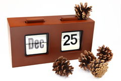 Christmas Pine Cone. Pine cone and calender at 25 December as Christmas stock photography