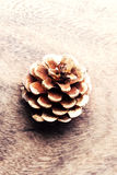 Christmas pine cone over wooden board Royalty Free Stock Photo