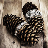 Christmas pine cone on wooden background with decorations. Chris Royalty Free Stock Images