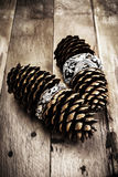 Christmas pine cone on wooden background with decorations. Chris Royalty Free Stock Photos