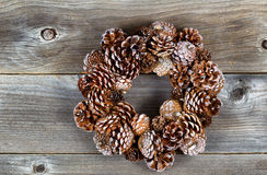 Christmas Pine Cone Wreath on Rustic Wood Royalty Free Stock Photography