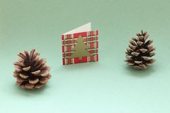 Christmas pine cones and a Christmas card on a plain background space.dec,The halls royalty free stock photos