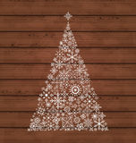Christmas pine made of snowflakes on wooden backgr Stock Photos