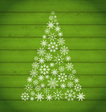 Christmas pine made of snowflakes on wooden background Royalty Free Stock Image