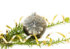 Christmas pine tree and bauble decoration. Celebrating Christmas with traditional pine tree branch and silver bauble decoration. Isolated on white Stock Images