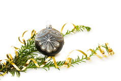Christmas pine tree branch and decoration. Celebrating Christmas with traditional pine tree branch and festive bauble. Isolated on white background royalty free stock photo