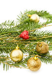 Christmas pine tree branch and decorations. Christmas celebration with golden baubles decorations, sparkling heart and evergreen. Isolated on white background Royalty Free Stock Photos