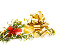 Christmas pine tree branch and decorations. Celebrating Christmas with traditional pine tree branch, festive golden decoration and red ribbon. Isolated on white stock image
