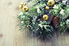 Christmas pine tree branch. On wooden background Stock Photos