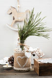 Christmas pine tree branch, wooden vintage toys, pins Royalty Free Stock Photos