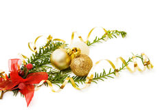 Christmas pine tree and golden baubles. Celebrating Christmas with golden baubles and red ribbons on traditional pine tree branch. Isolated on white Royalty Free Stock Photos