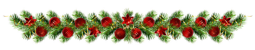 Christmas pine tree twigs and decorations garland. Isolated on white Stock Image